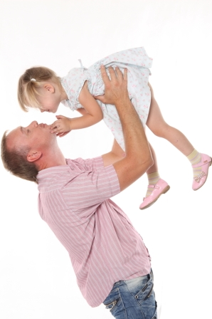 father holding daughter in air