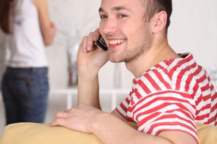 happy man on phone striped shirt